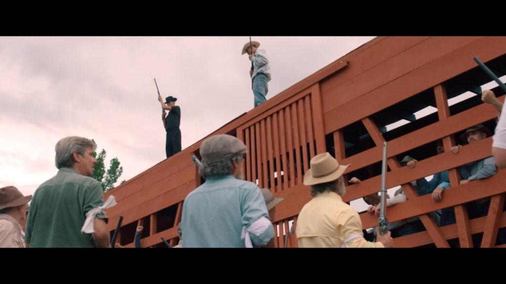 Reeenactors in the film Bisbee 17; men loading other men into a cattle car