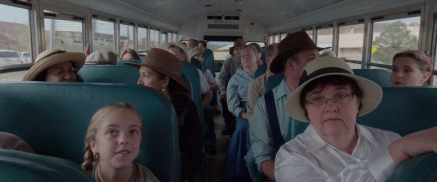 Reenactors on a bus in the film Bisbee '17
