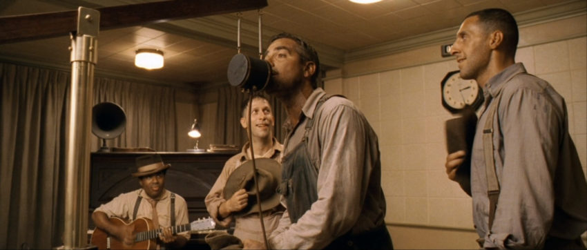 Four men in a 1930s recording studio, still from O Brother Where Art Thou