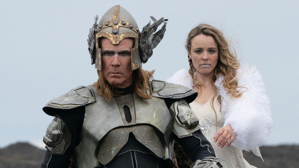 Still from the song Eurovision Song Contest, a man dressed in a Viking costume walking toward the camera with a woman in a white dress behind him
