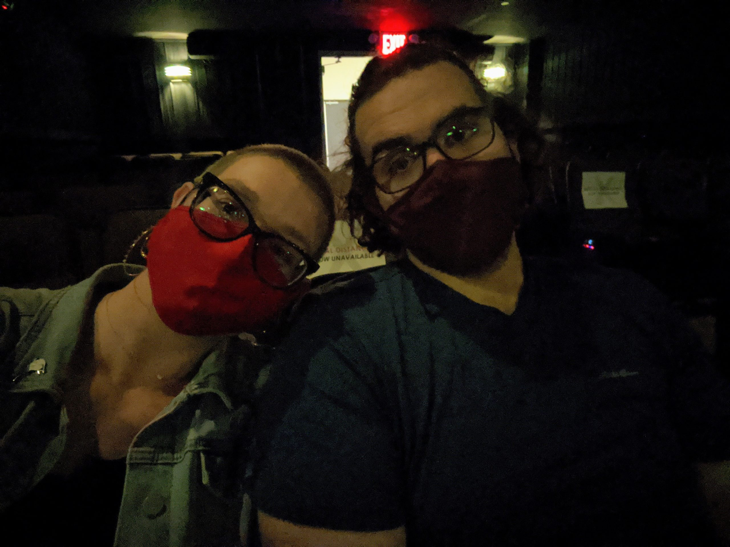 Selfie of Leah and Keith sitting in a dark movie theater