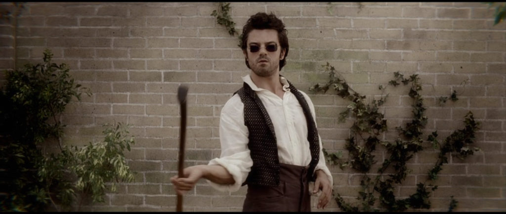 Still of Henry Sturges (Dominic Cooper) swinging an axe in Abraham Lincoln: Vampire Hunter