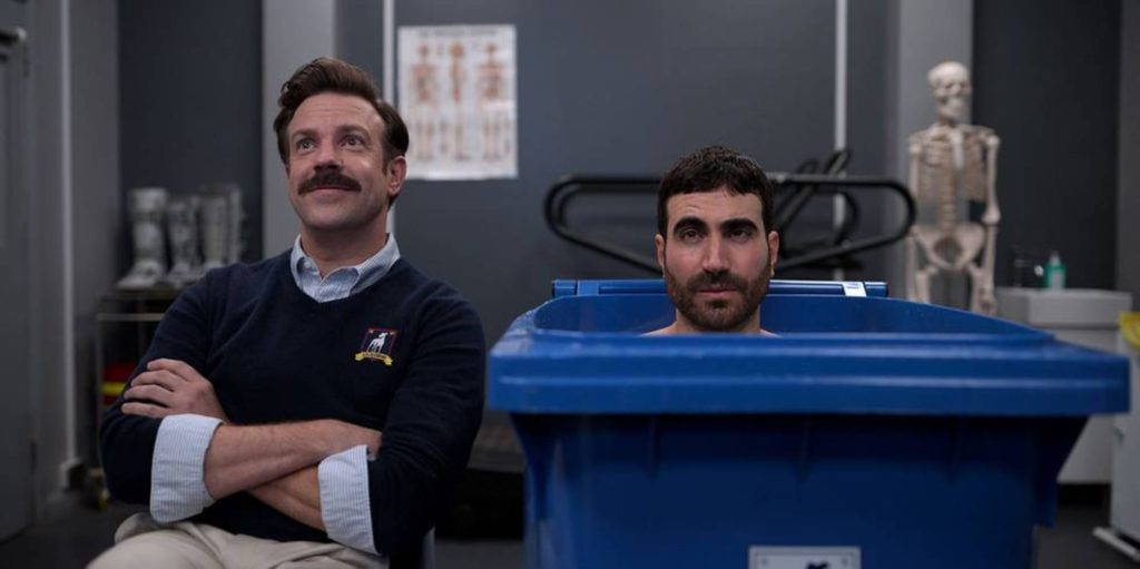 Jason Sudeikis as Ted Lasso and Brett Goldstein as Roy Kent in the show Ted Lasso